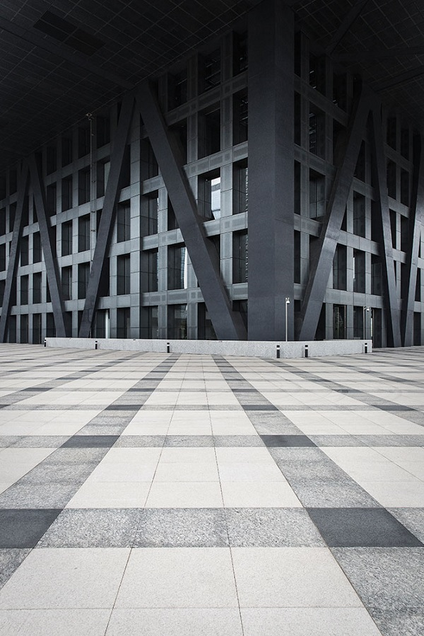 Under the elevated podium of the Rem Koolhaas-designed Shenzhen Stock Exchange Building.