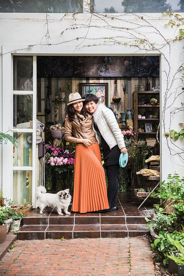 Florists outside their shop in the OCT-Loft complex, which has blossomed as a creative hub.