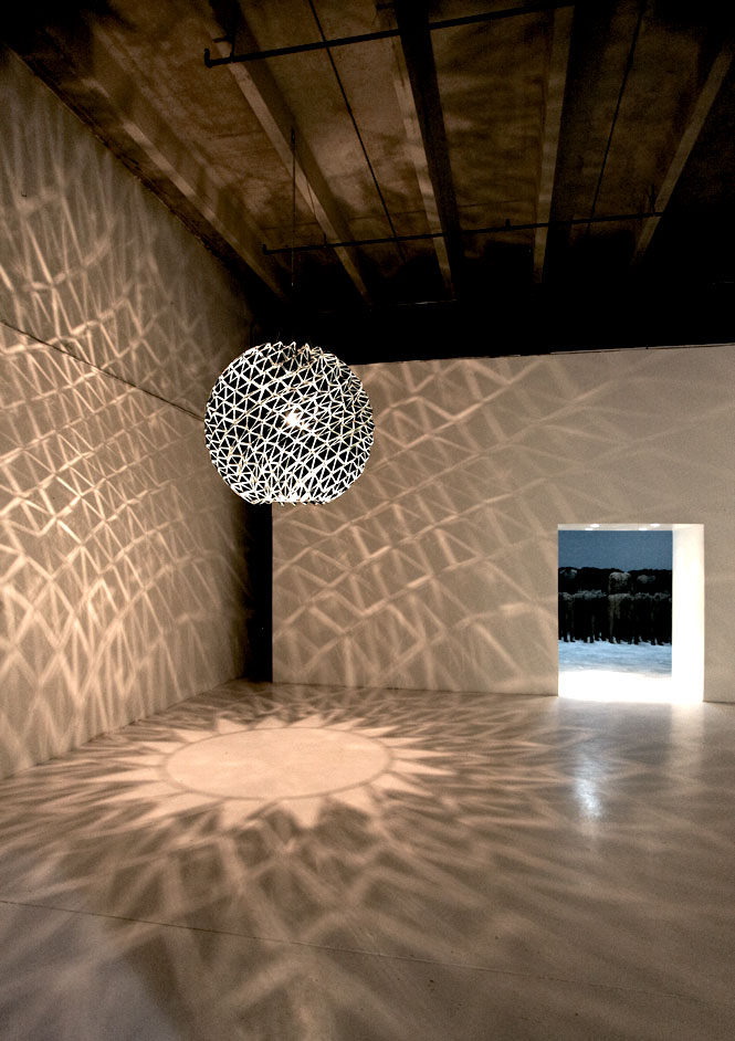 Inverted Berlin Sphere by installation artist Olafur Eliasson, on exhibit at the Margulies Collection at the Warehouse.