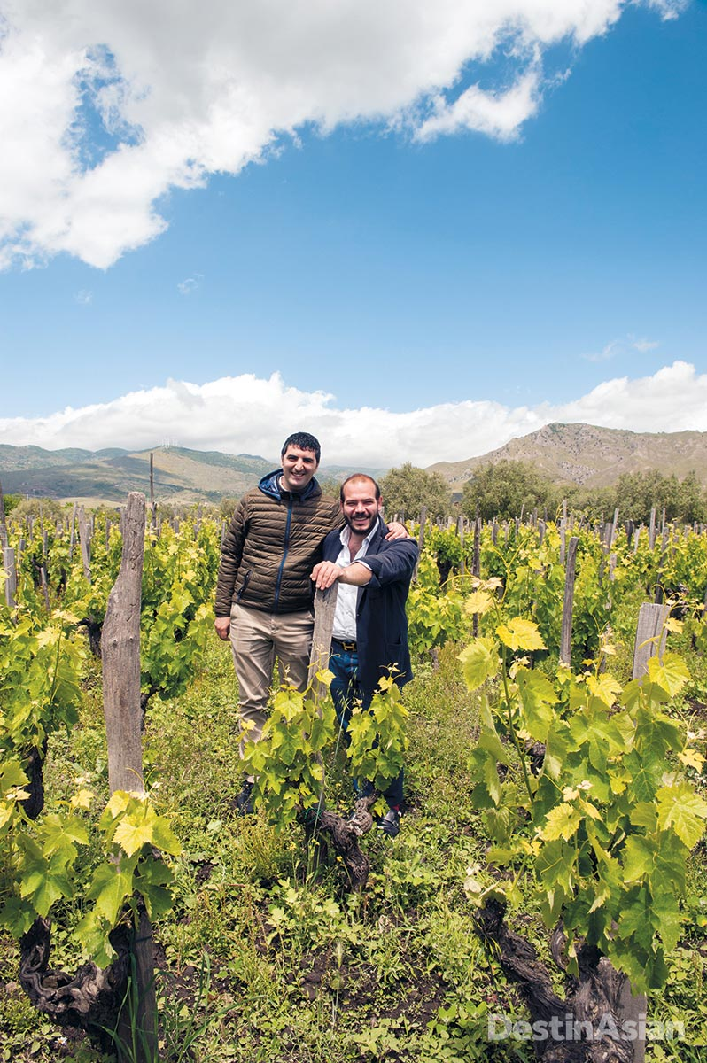 Sommelier Alessandro Pugliese (left) with winemaker Riccardo Negri in Graci's vineyards on Mount Etna.