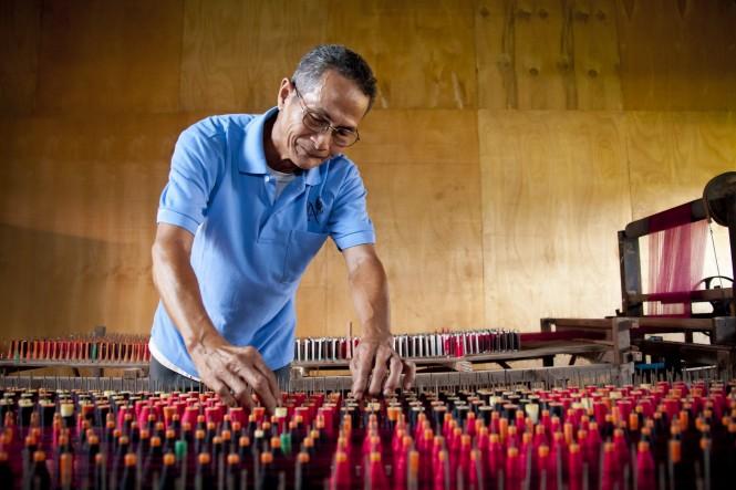 Silk krama weaving by a Artisan d'Angkor craftsman.