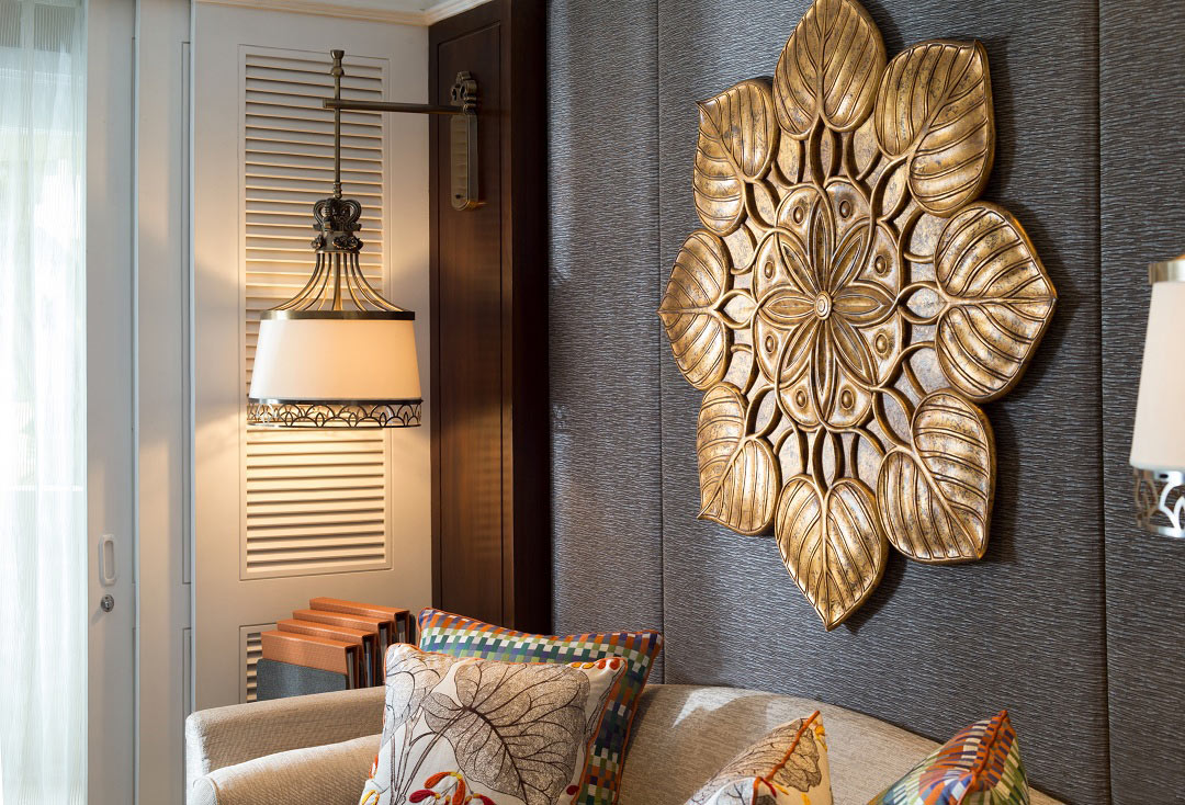 Lacquered tobacco-leaf artwork is featured in each of the renovated guest quarters.