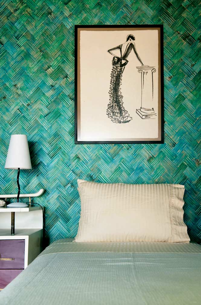 Fashion sketches hang on the walls of Mangenguey's cottages.