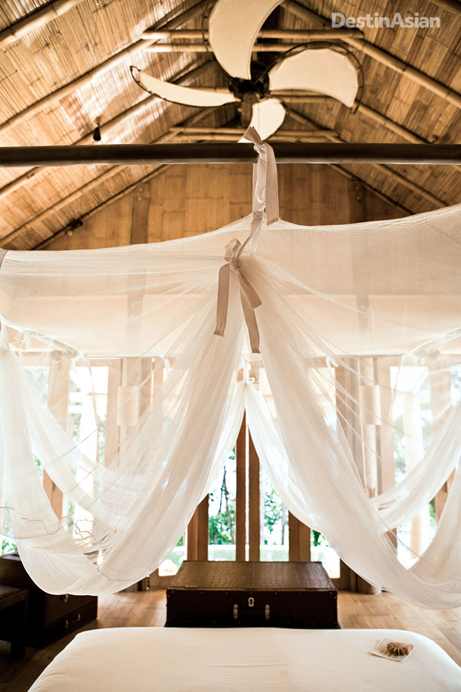 The resort's 36 eco-friendly villas feature sustainably sourced wood and organic cotton linens.
