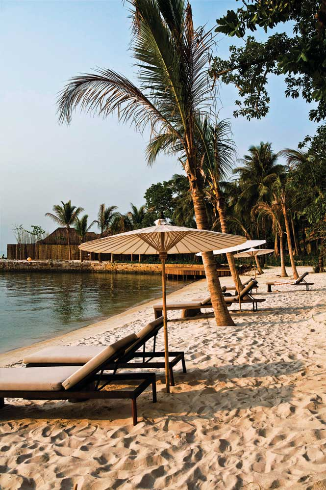 The main beach on Koh Ouen, where the resort's villas and facilities are located.