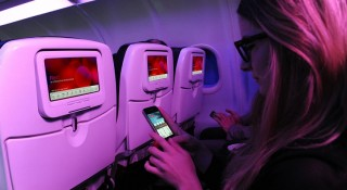 A partnership between Virgin America and Spotify will offer passengers access to the streaming app's millions of songs.