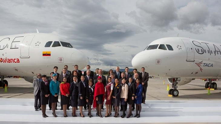 Representatives of Star Alliance member airlines in front of Star Alliance liveried planes.