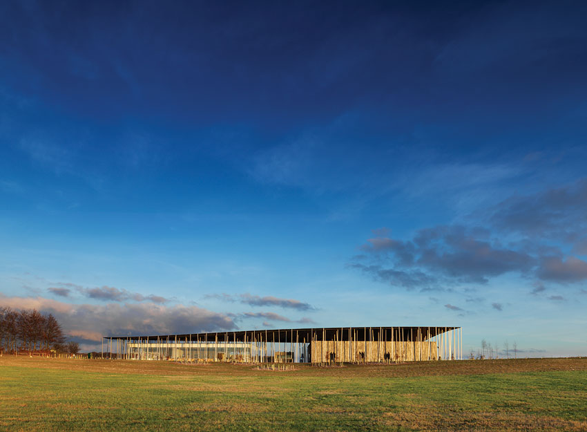 A new visitors pavilion now cuts a dramatic form across the English countryside.