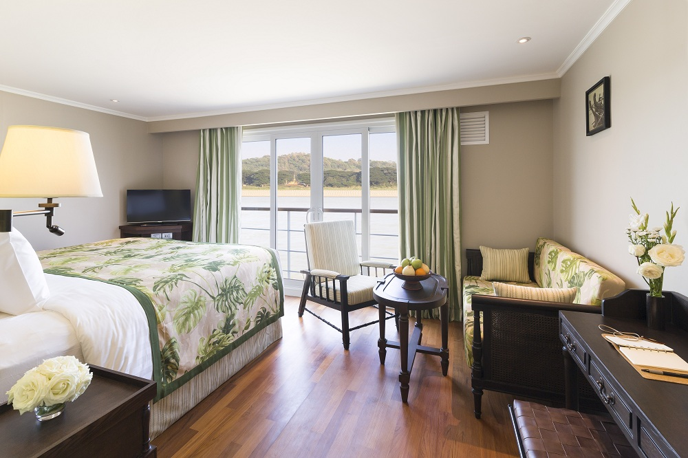 Teak wood floors and colorful textiles adorn the spacious cabin rooms.