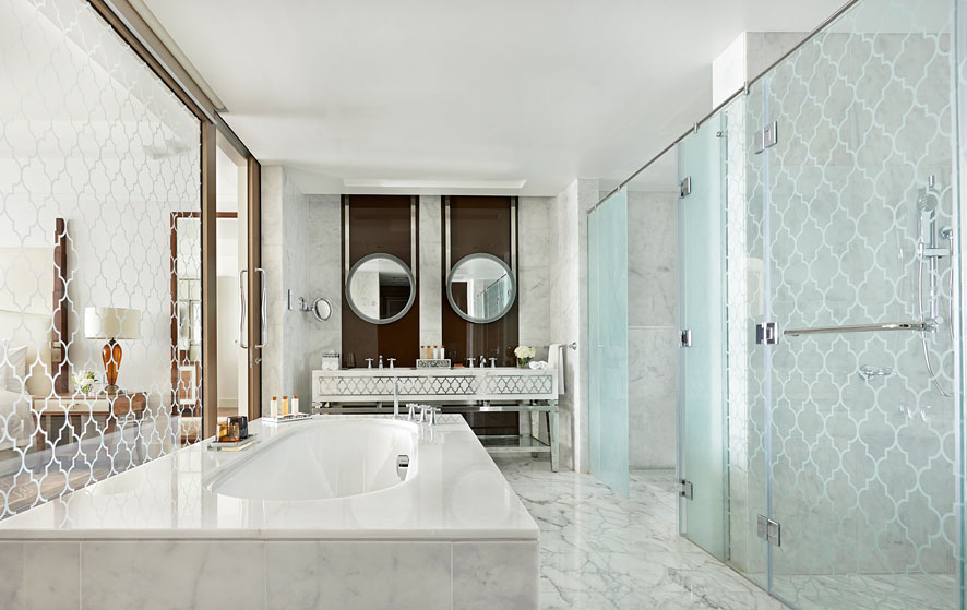 The rooms feature generous bathrooms clad in white marble.