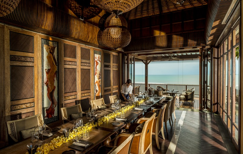 Sundara's three private dining rooms span two levels overlooking the blue waters of Jimbaran Bay.