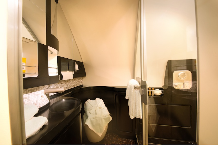Passengers flying in The Residence suite can freshen up in their private bathroom.