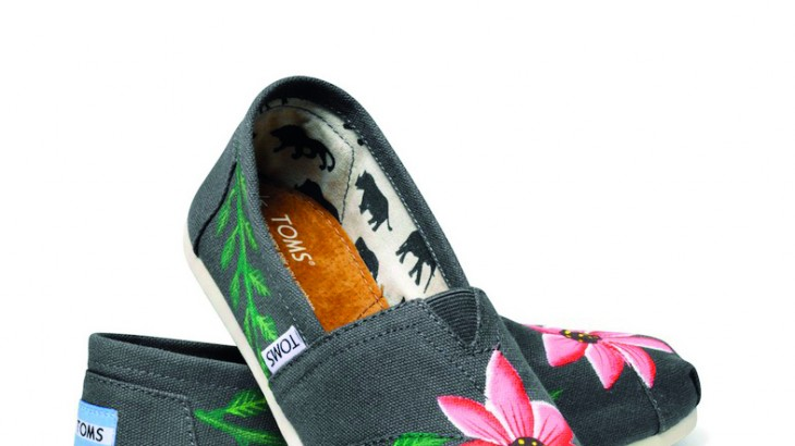 TOMS shoes creates jobs for local Haitian artists with shoe design.