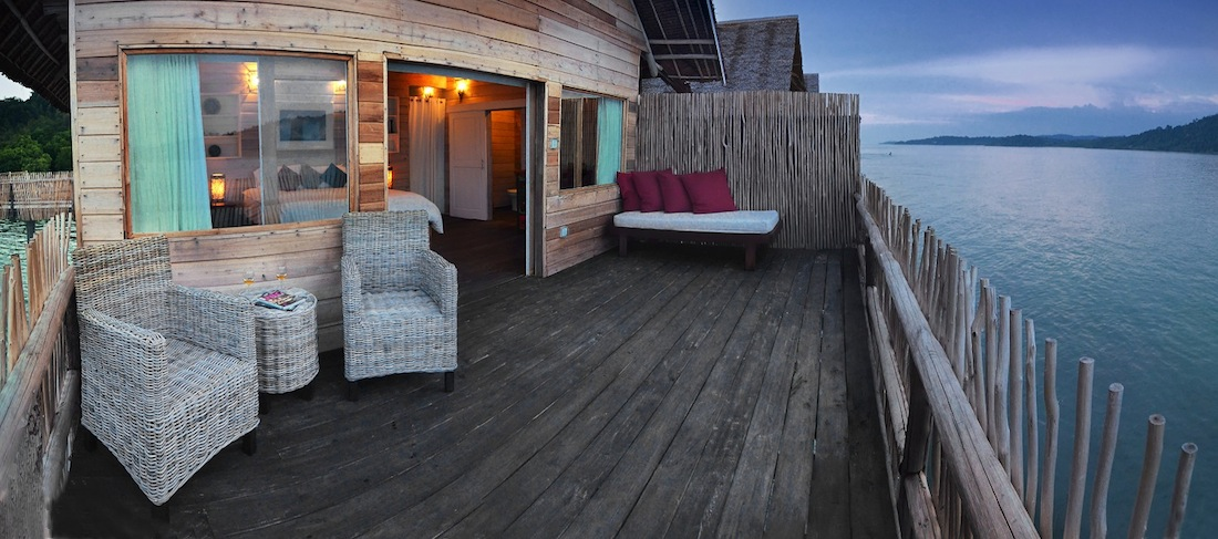 Catch views of the neighboring islands from the deck of your sea villa.