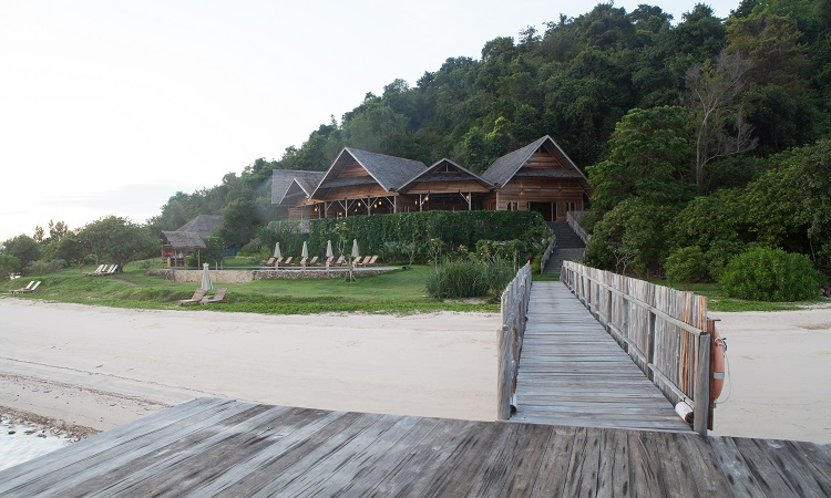 A wooden pier welcomes guests to Telunas Private Island.
