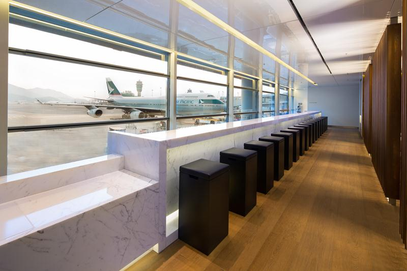 The Long Bar serves a variety of drinks and snacks with view across the airport.