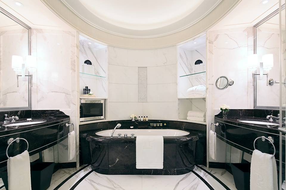 A marble clad bathroom.