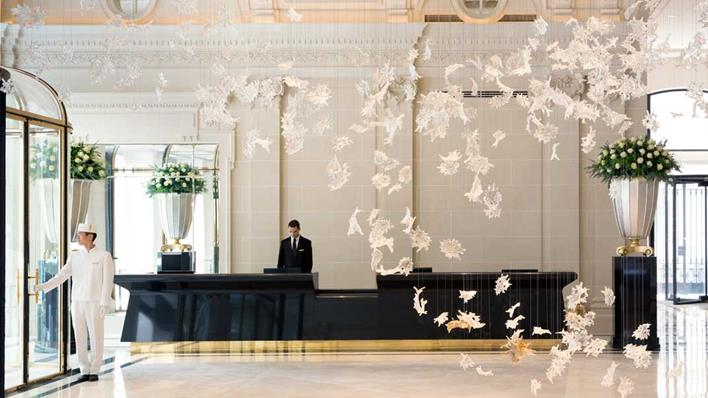 The lobby features an ethereal art installation.