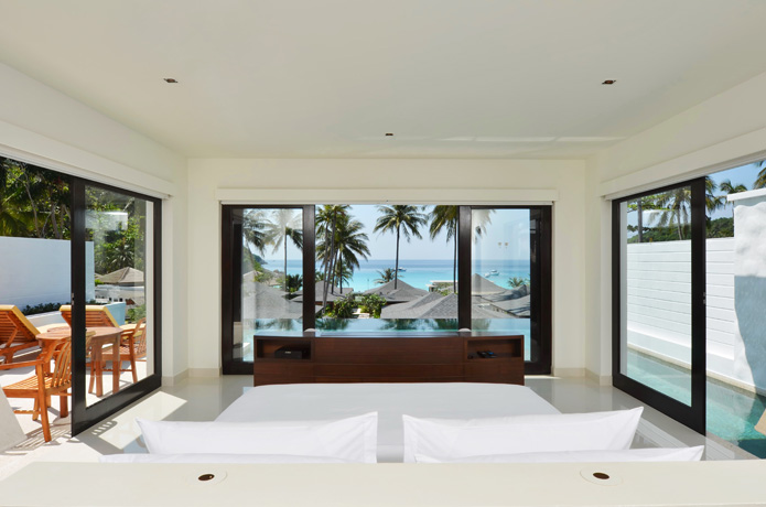A spacious room and a view at The Racha's Grand Pool Villa.