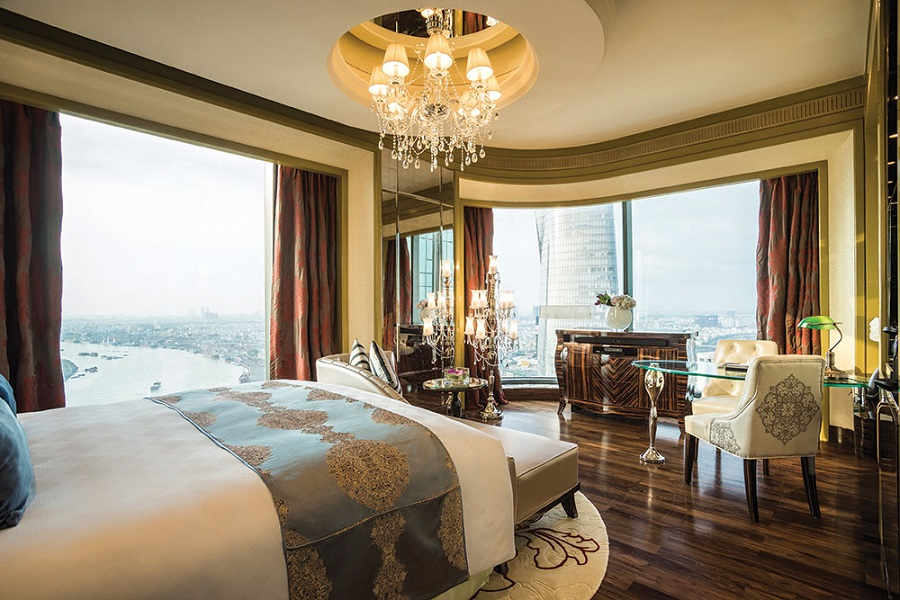 The Opulent Panorama Deluxe room at The Reverie Saigon overlooks the Saigon River.