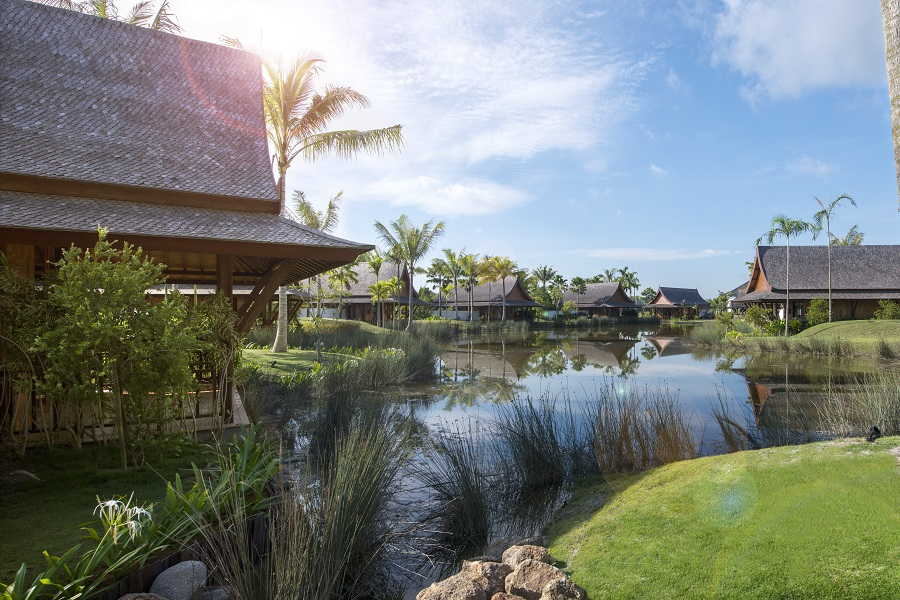 The Thai-style Lawan Village villas rise overlooking The Sanchaya's lagoon.