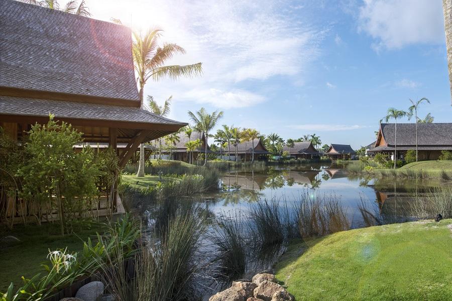 The Thai-style Lawan Village villas rise overlooking The Sanchaya's lagoon.