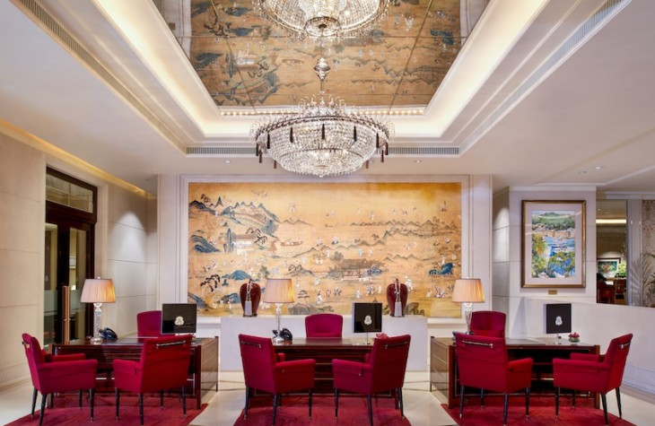 The reception area of the hotel is elegantly designed with traditional Chinese art.