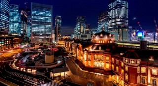 A view of the Tokyo Station Hotel at night.