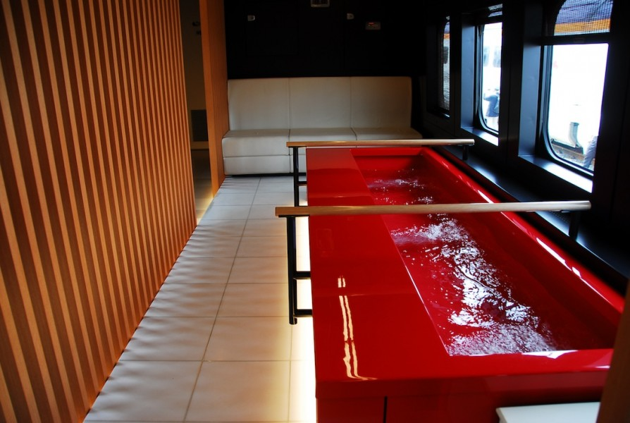 The window-facing tubs let riders relax while looking out at the Yamagata countryside.