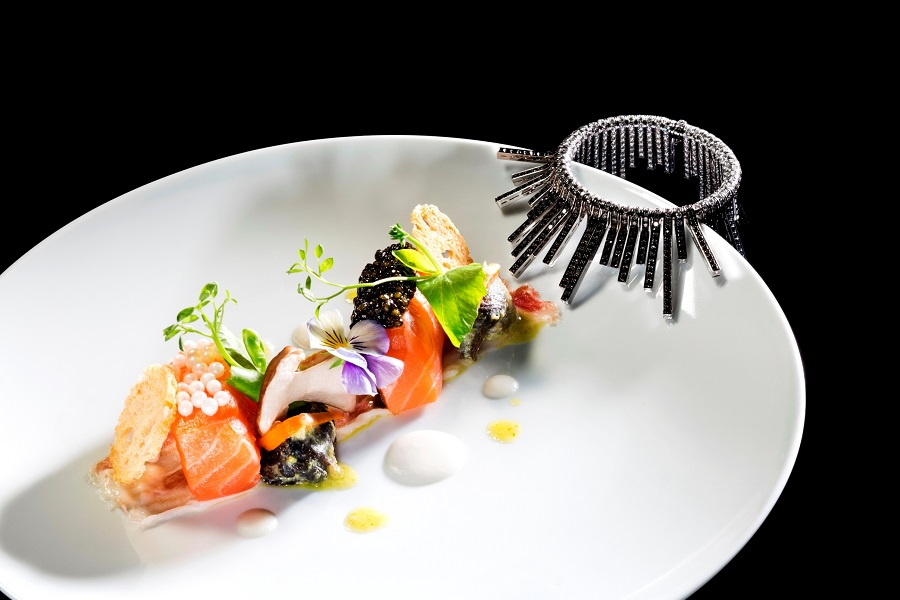 The menu's first course of cured salmon and two types of caviar was inspired by the Cascade 1930s bracelet.