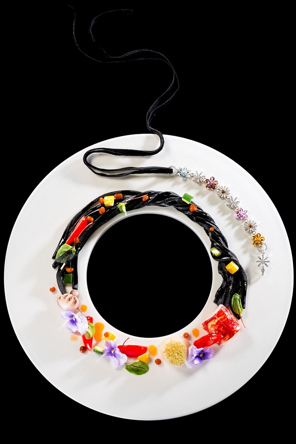 Colorful seafood fettucelle represents the Bloom 1970s necklace.