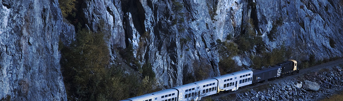 The Train of Le Massif de Charlevoix hugging a cliff.