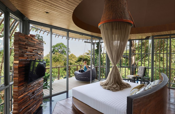 The bedroom of a two-story Tree Pool House villa.