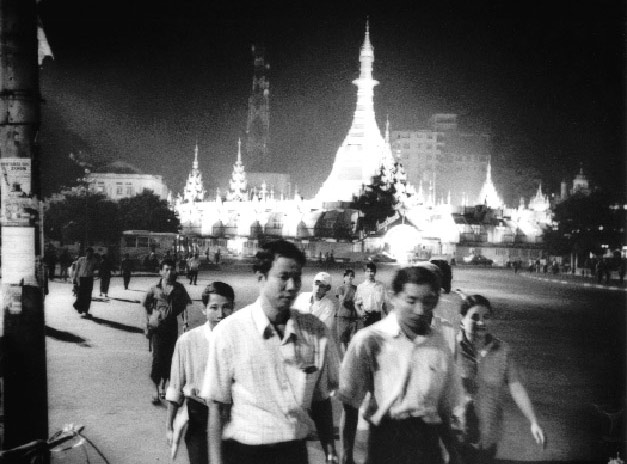 Office workers in central Yangon make their way home against the backdrop of the Sule Paya, a gleaming pagoda that is said to be 2,000 years old and to house a strand of the Buddha's hair.