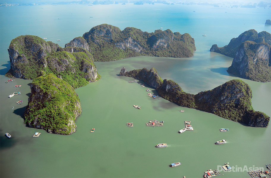 Looking down on Halong Bay from the seat of a Cessna seaplane.