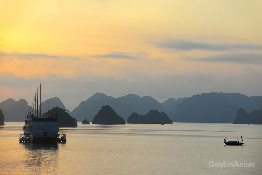 Sunset over a cluster of the bay's karst islands.