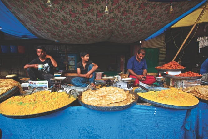 Vendors selling halwa sweets and parathas outside the Muslim shrine of Hazratbal in Kashmir.