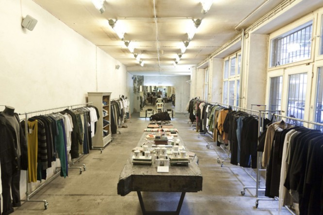 Bare racks and concrete floors display the avant-garde wares of Voo Store.