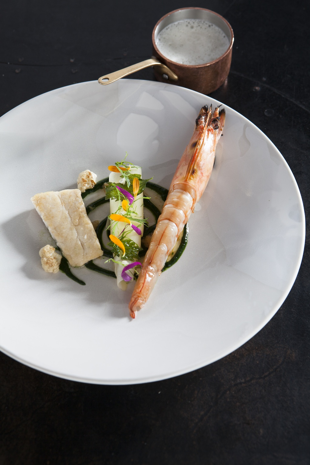 Vue de Monde's prawn, nettle with young garlic and smoked barramundi. Photo by Simon Griffiths