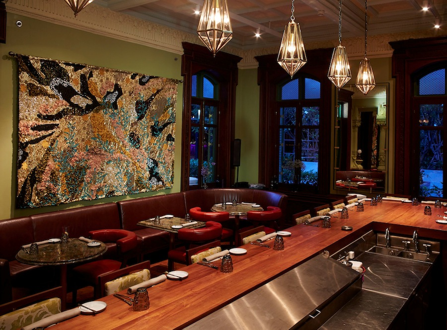 Thai decor and an open kitchen are part of the main dining room, which serves a travel-inspired menu.