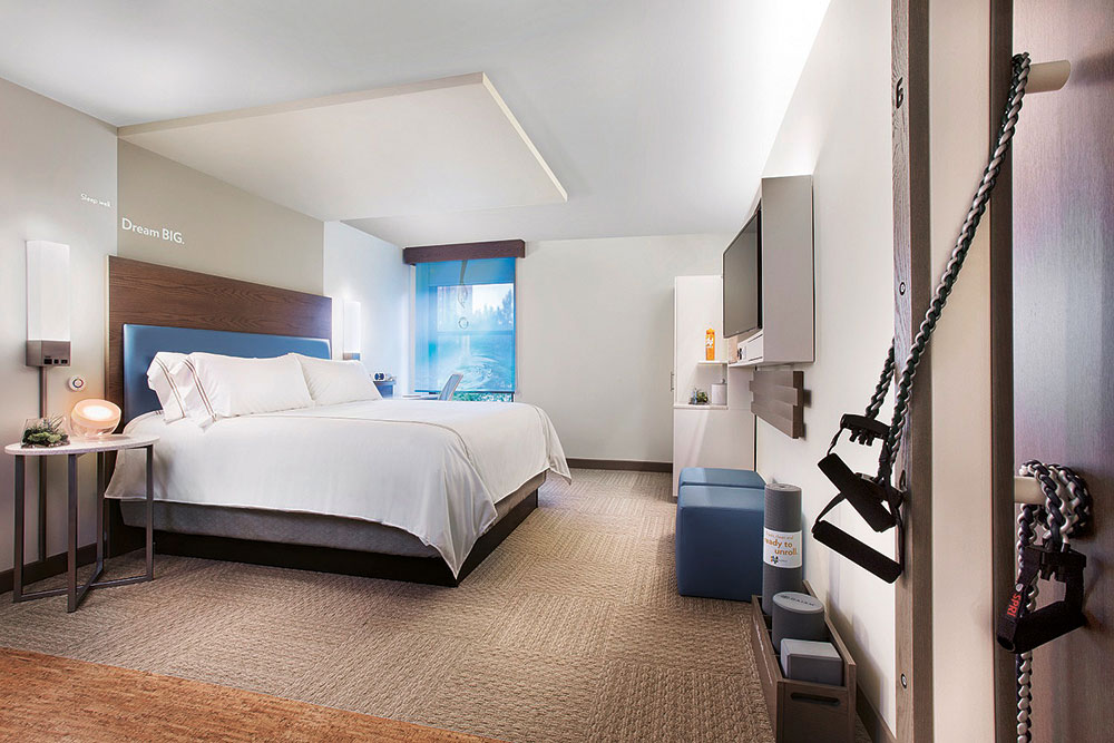 Guest quarters at Even Hotels come with in-room fitness zones.