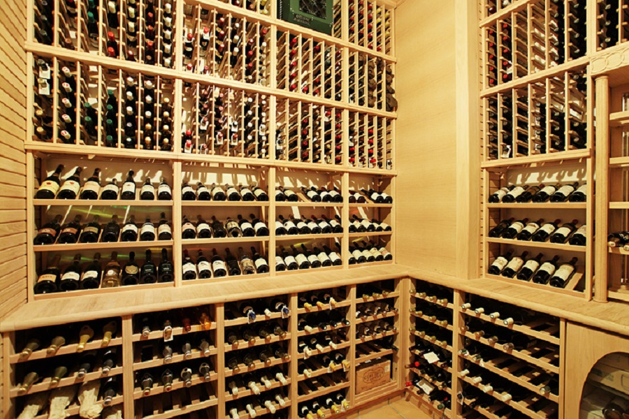 Behind a solid mahogany door, the wine cellar has a museum-like collection of vintage wines.