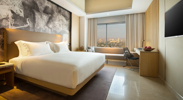 The rooms that are softly accented by light timber and dreamy murals overlook the 300-year old city and the imposing silhouettes of the volcanoes that ring around Solo.