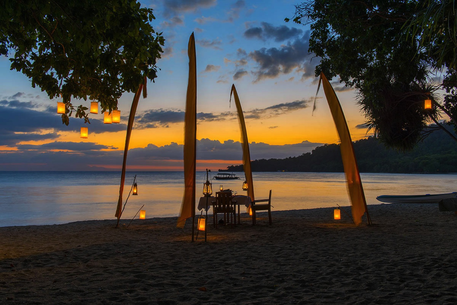 Stunning beach view at the Amanwana during sunset.