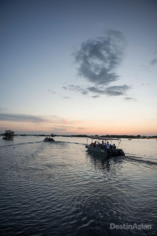 The skiffs returning to the main boat after a visit to the floating village of Kong Meas.