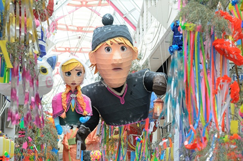 Papier-mâché hangs from the ceilings in the form of characters from  Disney's Frozen.