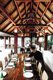 A dining terrace at Baan Suan Rim Ping, a riverside restaurant designed by architect-owner Chulathat Kitibutr to envoke a northern Thai village