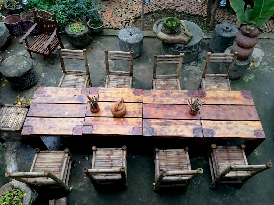 Backyard Bia Hoi's rustic decor in a garden setting.