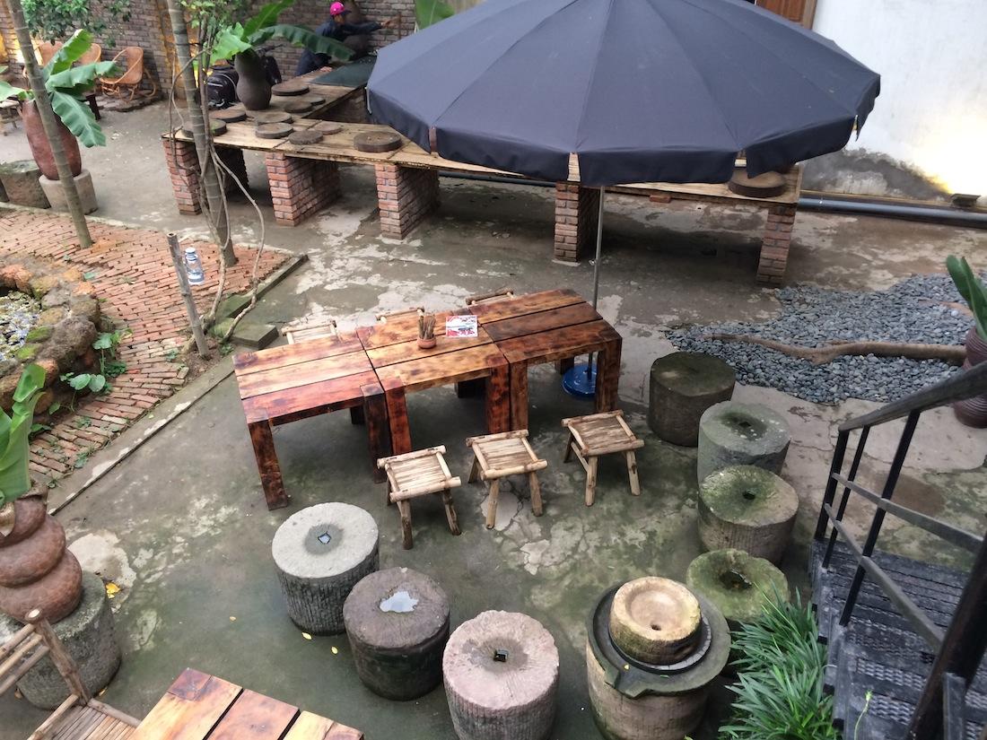 Enjoy streetside culture in a garden setting at Backyard Bia Hoi.