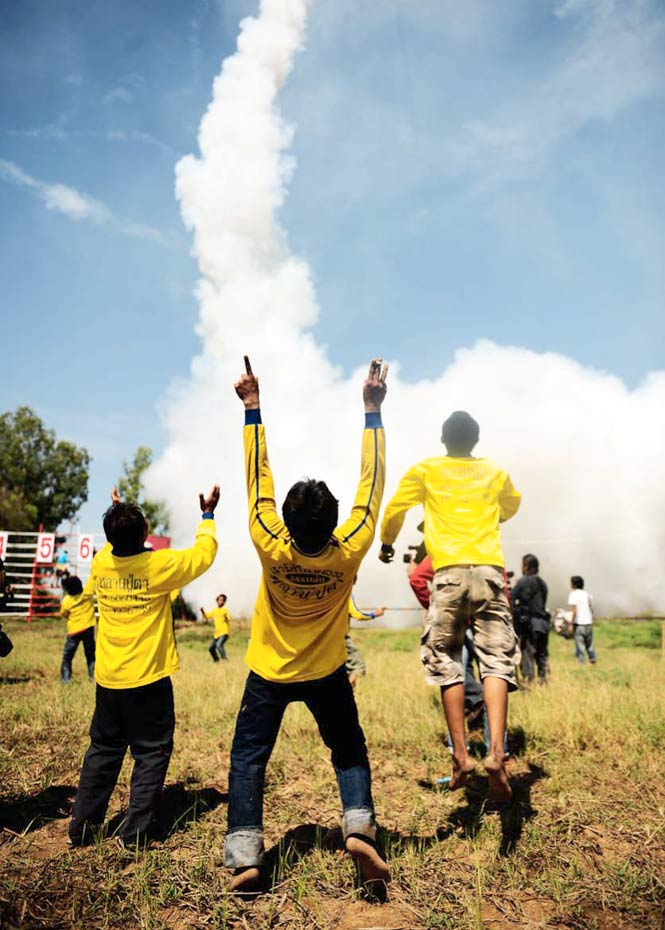 Cheering at the launch of a larger projectile.